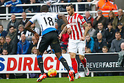 Stoke City Forward Marko Arnautovic takes on Newcastle United Defender Chancel Mbemba  during the Barclays Premier League match between Newcastle United and Stoke City at St. James's Park, Newcastle, England on 31 October 2015. Photo by Craig McAllister.
