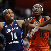 UNCASVILLE, CONNECTICUT- JUNE 3:   Rachel Hollivay #14 of the Atlanta Dream and Chiney Ogwumike #13 of the Connecticut Sun jostle for position on a free throw during the Atlanta Dream Vs Connecticut Sun, WNBA regular season game at Mohegan Sun Arena on June 3, 2016 in Uncasville, Connecticut. (Photo by Tim Clayton/Corbis via Getty Images)