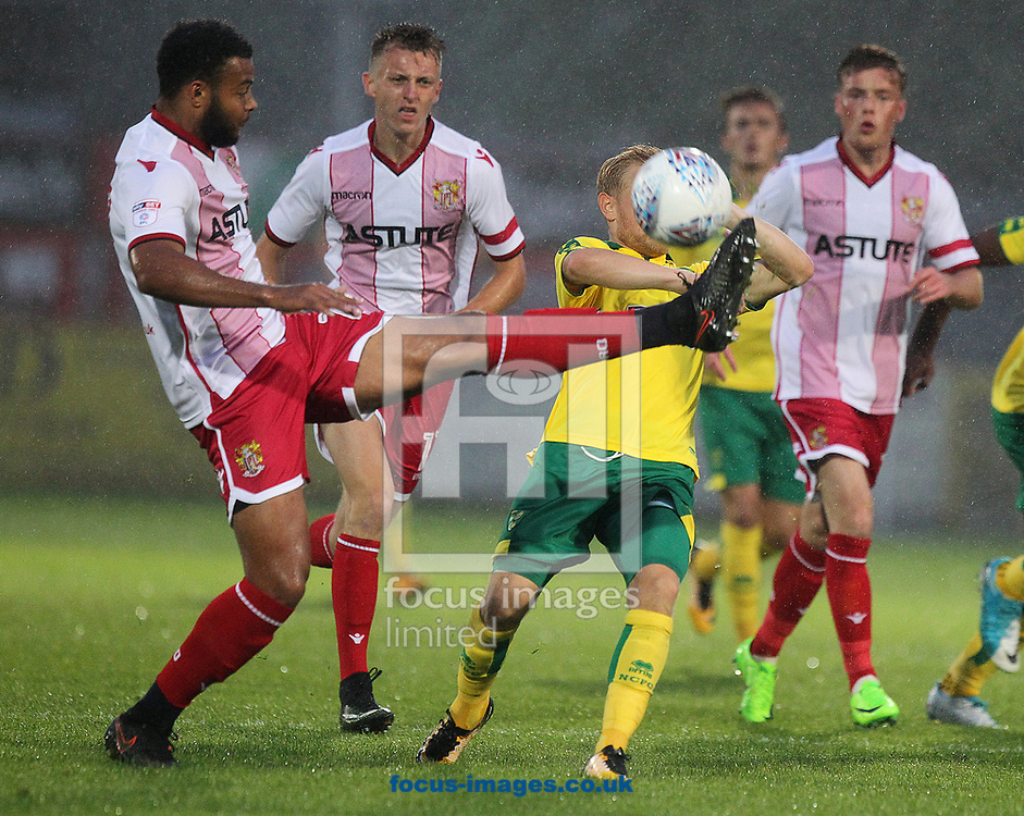 Alex Pritchard of Norwich ducks out of the way of the high boot of Ryan Johnson of Stevenage during the Pre-season Friendly match at the Lamex Stadium, Stevenage<br /> Picture by Paul Chesterton/Focus Images Ltd +44 7904 640267<br /> 11/07/2017