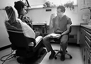 Dr. Michael Glick (right) speaks with a patient in 1989 at the Infectious Disease Clinic at Temple University in Philadelphia, Pennsylvania. The Infectious Disease Clinic at Temple University, was established in 1988 by Dr. Glick to treat people with HIV from throughout the region. (Photo by William Thomas Cain/Cain Images)