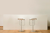 Barstools at counter in house