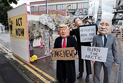 "© Licensed to London News Pictures;28/08/2020; Bristol, UK. Circus and physical theatre performers dressed as political figures Boris Johnson, Michael Gove, Jacob Rees-Mogg, Dominic Cummings, Donald Trump and Vladimir Putin, with masks made by Bim Mason, Director of Circomedia @bigheadbim and @rapiddissent on Instagram, do a walkabout as part of Extinction Rebellion protest in Bristol Harbourside on the first day of a bank holiday weekend of protest action titled ""Bristol Rebellion: We Want To Live"". XR are protesting in Bristol and other cities in the UK against climate change, leading up to a protest in London starting on 01 September. XR say that despite clear scientific evidence of the deadly climate and ecological emergency, the UK government are refusing to take the urgent action needed to avoid mass extinction. XR say we need politicians to support the Climate and Ecological Emergency Bill. During the coronavirus covid-19 pandemic, climate change is being forgotten but it is still an emergency that is happening, the elephant in the room. Photo credit: Simon Chapman/LNP."