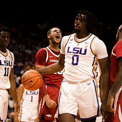 Feb 2, 2019; Baton Rouge, LA, USA; Arkansas Razorbacks forward Daniel Gafford (10) reacts after a basket and drawing a foul from LSU Tigers forward Naz Reid (0) during the first half at the Maravich Assembly Center. Mandatory Credit: Derick E. Hingle-USA TODAY Sports