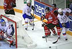 Mats Trygg of Norway (R) vs Dany Heatley (15) and Martin St.Louis (26) of Canada at play-off round quarterfinals ice-hockey game Norway vs Canada at IIHF WC 2008 in Halifax,  on May 14, 2008 in Metro Center, Halifax, Nova Scotia,Canada. (Photo by Vid Ponikvar / Sportal Images)