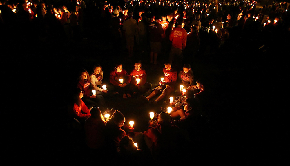 One Year<br /> Virginia Tech students hold candles in a heart shape at a candlelight vigil on the drillfield during the Virginia Tech Day of Remembrance.  April 16th, 2008 marked the one year anniversary of the massacre on the campus of Virginia Tech were 32 people were murdered.