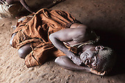 James is acting out a traditional story in the village of Mukuno, Uganda. He is one of the elders of the traditional Batwa pygmies from the Bwindi Impenetrable Forest in Uganda. They were indigenous forest nomads before they were evicted from the Bwindi Impenetrable Forest when it was made a World Heritage site to protect the mountain gorillas. The Batwa Development Program now supports them.