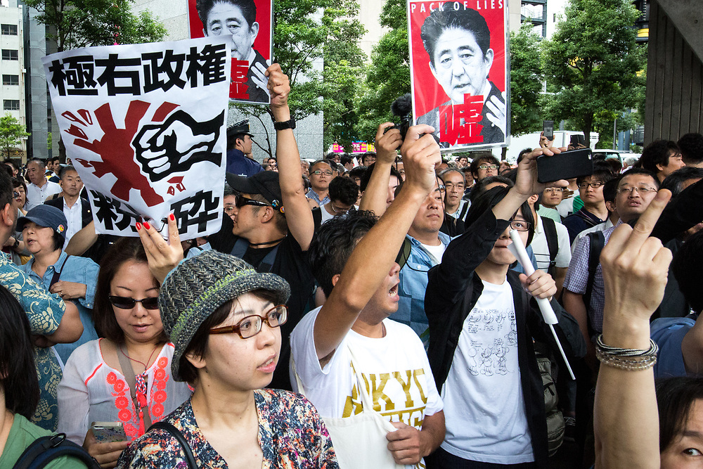 "TOKYO, JAPAN - JULY 1: Anti-Abe protesters gathers and chant ""Abe wa Yamero!"" ""Resign Prime Minister Abe!"" during the speech of Japanese Prime Minister Shinzo Abe for his candidate Aya Nakamura of main opposition, Liberal Democratic Party (LDP) in Akihabara, Tokyo, Japan on July 1, 2017. Tokyo Metropolitan Assembly election will be held on July 2. (Photo: Richard Atrero de Guzman/NUR Photo)"