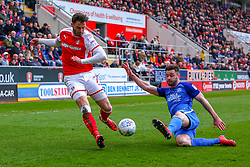 Andrew Hughes of Peterborough United kicks the ball out to break down an attack from Anthony Forde of Rotherham United - Mandatory by-line: Ryan Crockett/JMP - 30/03/2018 - FOOTBALL - Aesseal New York Stadium - Rotherham, England - Rotherham United v Peterborough United - Sky Bet League One