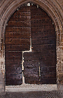 Close-up of an ancient wooden gate to the Pope's Palace in Avignon, France.