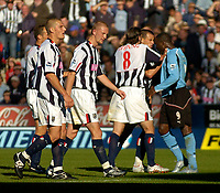 Photo. Glyn Thomas. Digitalsport<br /> West Bromwich Albion v Fulham. <br /> Barclays Premiership. 18/09/2004.<br /> Fulham's Andy Cole (R) squares up to and aims a punch at West Brom's Neil Clement (second from R) after Clement was shown the red card. Cole was also then shown the red card.