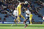 Jermaine Beckford challenges during the Sky Bet Championship match between Preston North End and Milton Keynes Dons at Deepdale, Preston, England on 16 April 2016. Photo by Pete Burns.