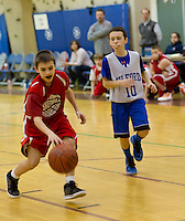 Steven Sevegjarto of Lou Athanas Laconia dribbles down court with Gilford's Korey Weston in the senior boys division game during the annual Francoeur/Babcock basketball Tournament Friday evening.  (Karen Bobotas/for the Laconia Daily Sun)