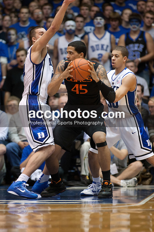 DURHAM, NC - JANUARY 02: Miles Plumlee #21 and Seth Curry #30 of the Duke Blue Devils pressure Julian Gamble #45 of the Miami Hurricanes on January 02, 2011 at Cameron Indoor Stadium in Durham, North Carolina. Duke won 63-74. (Photo by Peyton Williams/Getty Images) *** Local Caption *** Miles Plumlee;Seth Curry;Julian Gamble