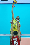 Brazil'Wallace De Souza attacks against Russia's Pavel Moroz while volleyball match between Brazil and Russia during the 2014 FIVB Volleyball World Championships at Spodek Hall in Katowice on September 14, 2014.<br /> <br /> Poland, Katowice, September 14, 2014<br /> <br /> For editorial use only. Any commercial or promotional use requires permission.<br /> <br /> Mandatory credit:<br /> Photo by &copy; Adam Nurkiewicz / Mediasport