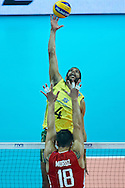 Brazil'Wallace De Souza attacks against Russia's Pavel Moroz while volleyball match between Brazil and Russia during the 2014 FIVB Volleyball World Championships at Spodek Hall in Katowice on September 14, 2014.<br /> <br /> Poland, Katowice, September 14, 2014<br /> <br /> For editorial use only. Any commercial or promotional use requires permission.<br /> <br /> Mandatory credit:<br /> Photo by © Adam Nurkiewicz / Mediasport