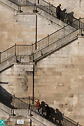Kent people on Jacob's Ladder steps at Ramsgate's harbour, on 8th January 2019, in Ramsgate, Kent, England. The Port of Ramsgate has been identified as a 'Brexit Port' by the government of Prime Minister Theresa May, currently negotiating the UK's exit from the EU. Britain's Department of Transport has awarded to an unproven shipping company, Seaborne Freight, to provide run roll-on roll-off ferry services to the road haulage industry between Ostend and the Kent port - in the event of more likely No Deal Brexit. In the EU referendum of 2016, people in Kent voted strongly in favour of leaving the European Union with 59% voting to leave and 41% to remain.
