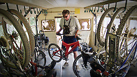 JEROME A. POLLOS/Press..Ric Clarke helps load bikes onto one of the shuttle buses that transport Route of the Hiawatha riders back to the 1.7-mile tunnel where most visitors start on the biking trail.
