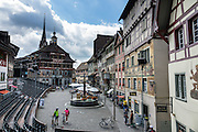 Bicyclists explore Stein am Rhein, which has a well-preserved medieval center with beautiful frescoes, in Schaffhausen Canton, Switzerland, Europe.