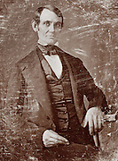 A young, beardless Abraham Lincoln, three-quarter length portrait, seated, facing front 1846 or 1847.