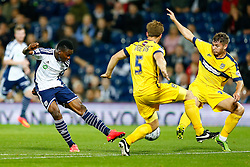 Brown Ideye of West Brom strikes the ball past Johnny Mullins of Oxford United - Photo mandatory by-line: Rogan Thomson/JMP - 07966 386802 - 26/08/2014 - SPORT - FOOTBALL - The Hawthorns, West Bromwich - West Bromwich Albion v Oxford United - Capital One Cup Round 2.