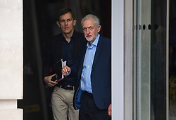 © London News Pictures. FILE PICTURE:  19/06/2016. London, UK. Leader of the Labour Party JEREMY CORBYN (right) leaves BBC Broadcasting House in London with Director of Strategy SEUMAS MILNE (left) after appearing on the Andrew Marr Show. A BBC Panorama documentary, focusing on alleged anti semitism in the Labour Party is due to run this evening. Photo credit: Ben Cawthra/LNP