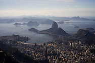 A view of Botafogo beach and the Sugarloaf from the Cristo Redentor (Christ statue) at the top of the hill in Rio de Janeiro, Brazil. Photo by Andrew Tobin/Tobinators Ltd