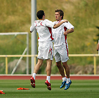Photo: Chris Ratcliffe.<br />England Training Session. FIFA World Cup 2006. 29/06/2006.<br />David Beckham (R) and Stuart Downing training.