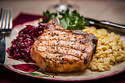 Sink your teeth into this juicy Pork Chop with dumplings created by Chef Ray Willey of Take the Night Off in Ft. Lauderdale, Florida. Photography by Jeffrey A McDonald
