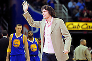 March 8, 2011; Cleveland, OH, USA; Cleveland Cavaliers power forward Anderson Varejao (17) ,who is injured for the rest of the season, says hello to fans during the third quarter against the Golden State Warriors at Quicken Loans Arena. The Warriors beat the Cavaliers 95-85. Mandatory Credit: Jason Miller-US PRESSWIRE