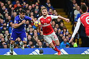 Chelsea forward Diego Costa (19) battles with Arsenal defender Shkodran Mustafi (20) during the Premier League match between Chelsea and Arsenal at Stamford Bridge, London, England on 4 February 2017. Photo by Jon Bromley.