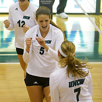 UNCW's Morgan Kline, top, Meredith Peacock, center, and Kaitlyn Cobb celebrate a point against Eastern Washington in the Hilton Garden Inn Wilmington Mayfaire Classic Sunday August 31, 2014 at Hanover Hall in Wilmington, N.C. (Jason A. Frizzelle)