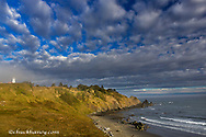 Morning light on the beach and lighthouse at Cape Blanco State Park, Oregon, USA