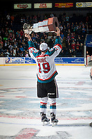 KELOWNA, CANADA - MAY 13: Dillon Dube #19 of Kelowna Rockets skates with the WHL Championship trophy on May 13, 2015 during game 4 of the WHL final series at Prospera Place in Kelowna, British Columbia, Canada.  (Photo by Marissa Baecker/Shoot the Breeze)  *** Local Caption *** Dillon Dube;
