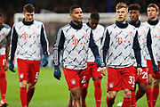 Bayern Munich forward Serge Gnabry, Bayern Munich defender Joshua Kimmich and other Bayern Munich players warm up before the Champions League match between Chelsea and Bayern Munich at Stamford Bridge, London, England on 25 February 2020.