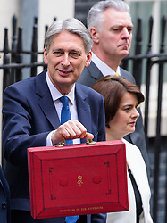 © Licensed to London News Pictures. 08/03/2017. London, UK. Philip Hammond MP, Jane Ellison MP and Simon Kirby MP leave 11 Downing Street in London before British Chancellor PHILIP HAMMOND delivers his 2017 Budget to Parliament. Photo credit: Ben Cawthra/LNP