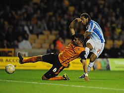 Huddersfield Town's Sean Scannell scores his sides second goal to make it 0 - 2 - Photo mandatory by-line: Dougie Allward/JMP - Mobile: 07966 386802 - 01/10/2014 - SPORT - Football - Wolverhampton - Molineux Stadium - Wolverhampton Wonderers v Huddersfield Town - Sky Bet Championship