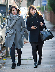 ©  London News Pictures. 26/11/2013. London, UK. Italian Sisters Elisabetta 'Lisa' (left) and Francesca (right, with handbag) Grillo, who are the former personal assistants to Charles Saatchi and Nigella  Lawson, arriving at Isleworth Crown Court in London. The Grillo Sisters Elisabetta and Francesca have both appeared on ITV's This Morning. Photo credit : Ben Cawthra/LNP