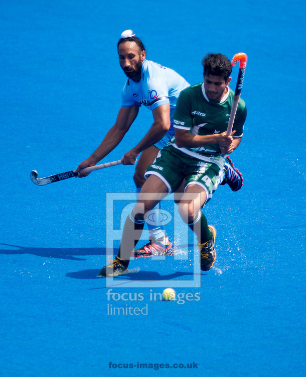 Muhammad Rizwan Jr of Pakistan and Talwinder Singh of India battle for the ball on day four of the Men's Hero Hockey World League Semi-Finals at Lee Valley Hockey Centre, Stratford<br /> Picture by Hannah Fountain/Focus Images Ltd 07814482222<br /> 18/06/2017
