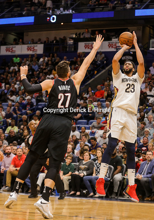 Mar 27, 2018; New Orleans, LA, USA; New Orleans Pelicans forward Anthony Davis (23) shoots over Portland Trail Blazers center Jusuf Nurkic (27) during the second quarter at the Smoothie King Center. Mandatory Credit: Derick E. Hingle-USA TODAY Sports