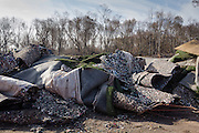 During the clean-up that followed, Sanitation workers piled soiled astroturf and rubber from a park at New Dorp Beach. The city had only recently spent over a million dollars to build a football field in the park. Residents picked over the wreckage on the beach looking for objects and photographs that washed out of their homes.