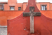 The wall with cross at the Templo de San Juan de Dios church in the historic city of San Miguel de Allende, Mexico.