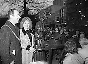 "Molly Malone Statue Unveiled. (R93)..1988..20.12.1988..12.20.1988..20th December 1988..""Dublin's Fair City"" received a millenniun gift to commemorate her most famous daughter, Molly Malone, when Jurys Hotel Group plc presented a specially commissioned sculpture to the people of Dublin. The sculpture was formally handed over by Michael McCarthy, MD,Jurys Hotel Group, to the Lord Mayor of Dublin, Councillor Ben Briscoe, TD, in an unveiling ceremony today at the corner of Grafton Street, Suffolk Street and Nassau Street..Molly Malone was created and fashioned in her traditional 17th century dress by Dublin born artist, Jeanne Rynhart, who was selected from a number of entries for the statue design, by the Dublin Millennium Board...Image shows Lord Mayor, Ben Briscoe and artist Jeanne Rynhart with her depiction of Molly Malone."