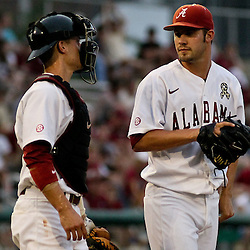 June 04, 2011; Tallahassee, FL, USA; Alabama Crimson Tide pitcher Adam Morgan (32) talks with catcher Brock Bennett  during the second inning of the Tallahassee regional of the 2011 NCAA baseball tournament against the Florida State Seminoles at Dick Howser Stadium. Mandatory Credit: Derick E. Hingle