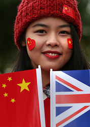 © Licensed to London News Pictures. 20/10/2015. London, UK. A girl carries a Chinese and Union flag in The Mall ahead of Chinese President Xi Jinping's four day State Visit to the United Kingdom. Photo credit: Peter Macdiarmid/LNP