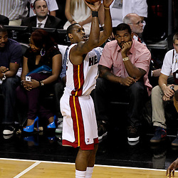 Jun 19, 2012; Miami, FL, USA; Miami Heat point guard Mario Chalmers (15) shoots against the Oklahoma City Thunder during the first quarter in game four in the 2012 NBA Finals at the American Airlines Arena. Mandatory Credit: Derick E. Hingle-US PRESSWIRE