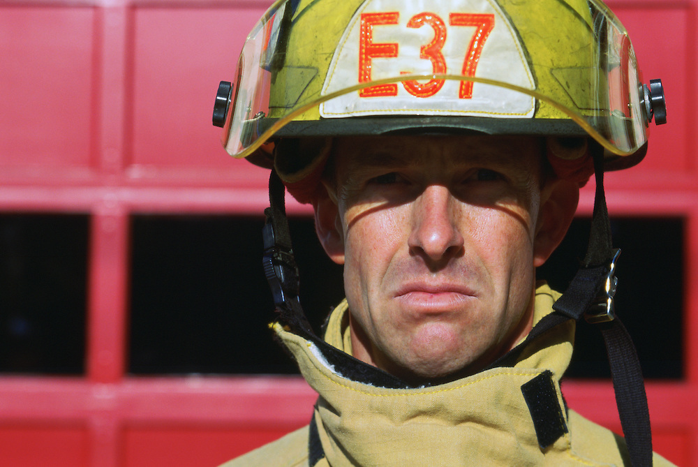 Portrait of frowning sad fireman