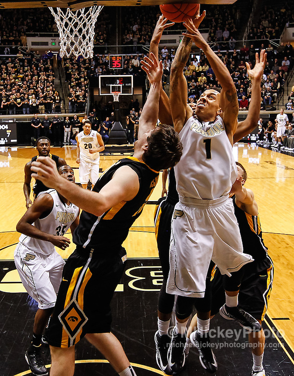 WEST LAFAYETTE, IN - JANUARY 27: Zach McCabe #15 of the Iowa Hawkeyes and Anthony Johnson #1 of the Purdue Boilermakers fight for a rebound at Mackey Arena on January 27, 2013 in West Lafayette, Indiana. Purdue defeated Iowa 65-62 in overtime. (Photo by Michael Hickey/Getty Images) *** Local Caption *** Zach McCabe; Anthony Johnson