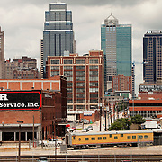 Downtown Kansas City Skyline and antique passenger trains in foreground.