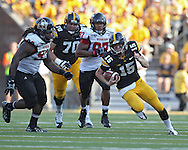 August 31 2013: Iowa Hawkeyes quarterback Jake Rudock (15) scrambles with the ball during the second half of the NCAA football game between the Northern Illinois Huskies and the Iowa Hawkeyes at Kinnick Stadium in Iowa City, Iowa on August 31, 2013. Northern Illinois defeated Iowa 30-27.