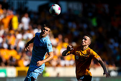 Diogo Jota of Wolverhampton Wanderers takes on Johann Gudmundsson of Burnley - Mandatory by-line: Robbie Stephenson/JMP - 25/08/2019 - FOOTBALL - Molineux - Wolverhampton, England - Wolverhampton Wanderers v Burnley - Premier League